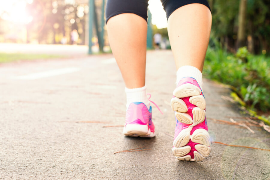 Woman wearing pink running shoes going for a walk