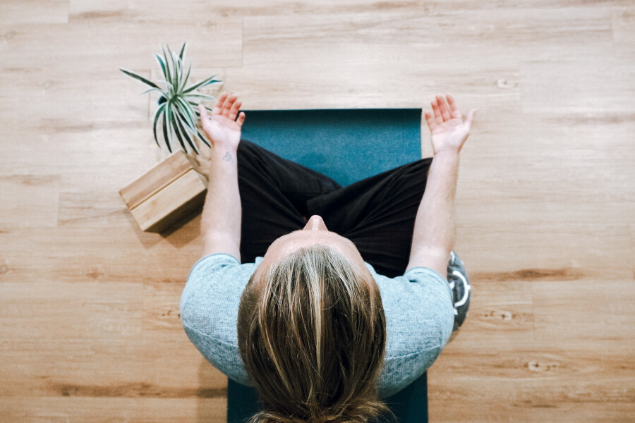 Man meditating with a health and wellness app