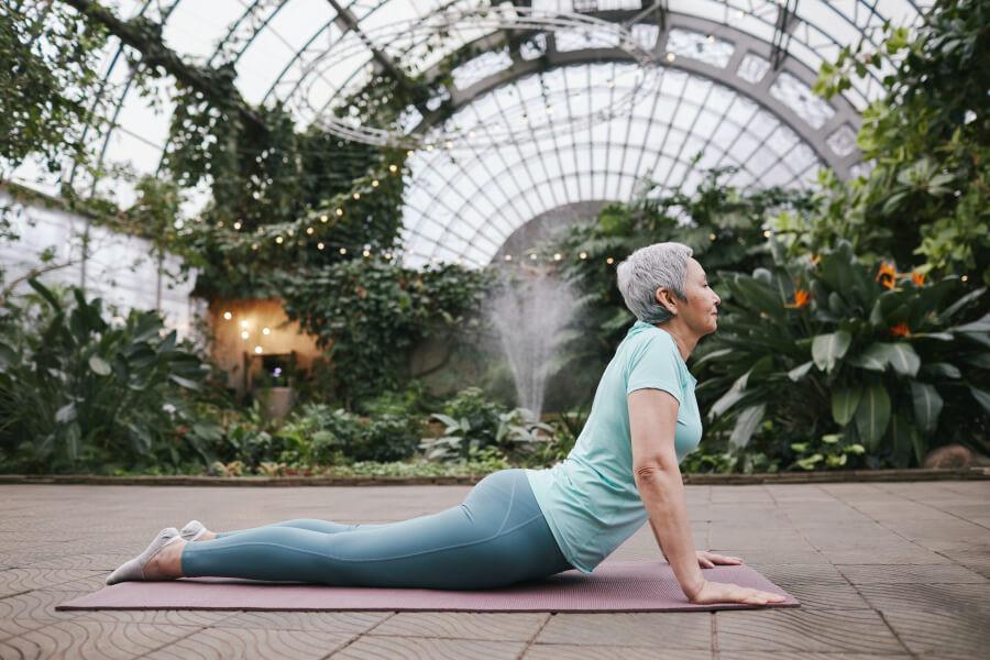 A woman doing cobra pose on a yoga mat