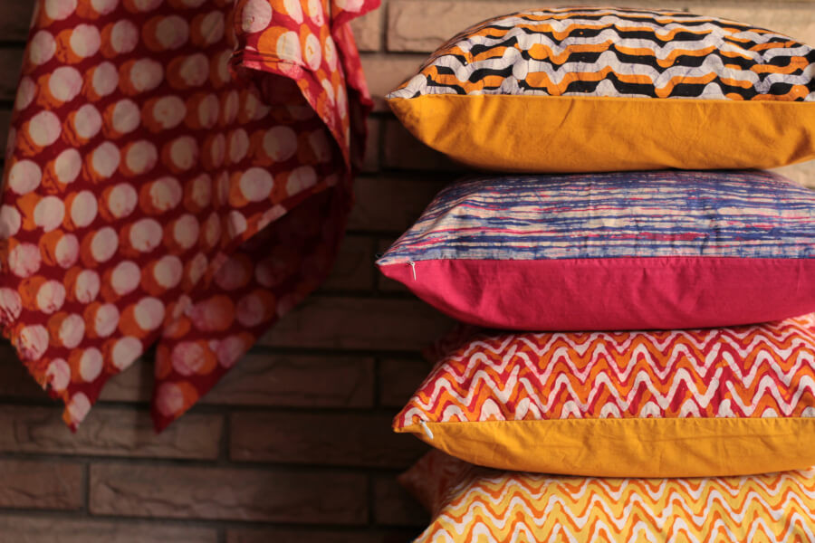A stack of colourful cushions