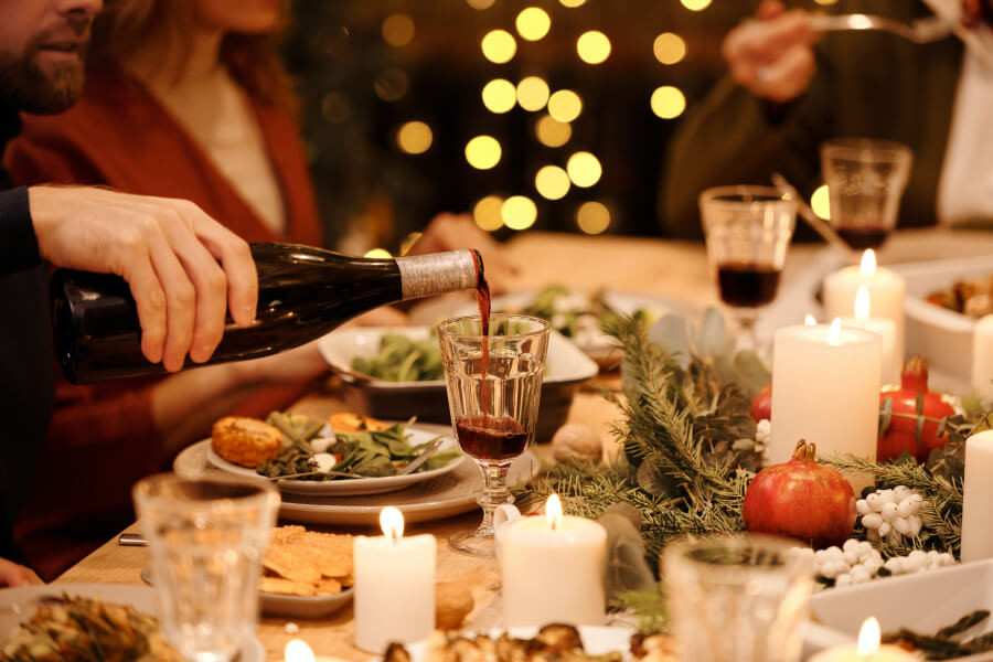 A dinner party with fairy lights in the background