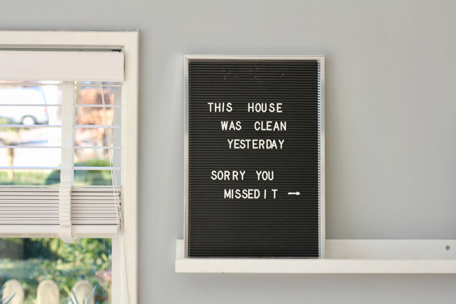A black letter board with the words 'This house was clean yesterday. Sorry you missed it'