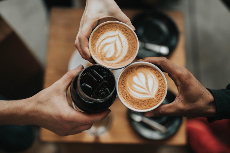 Three people enjoying coffee together
