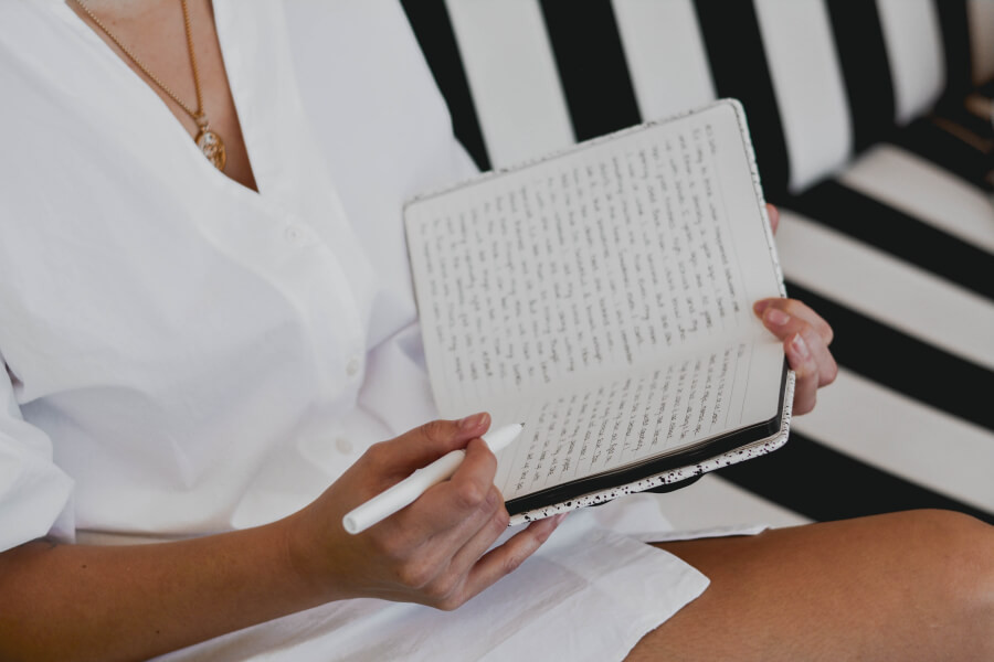 A woman writing in her journal