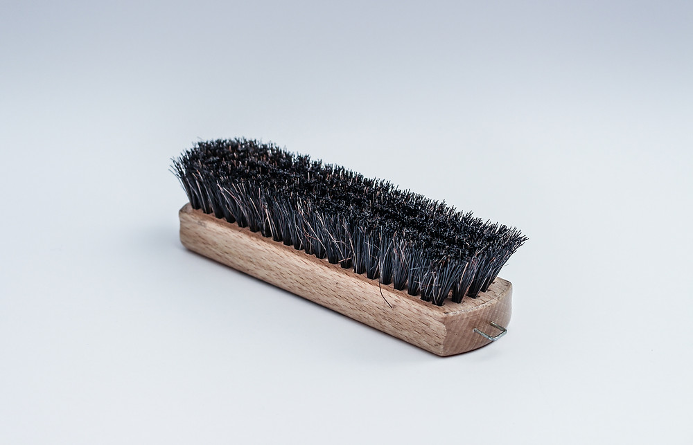 Stiff-bristled brush
