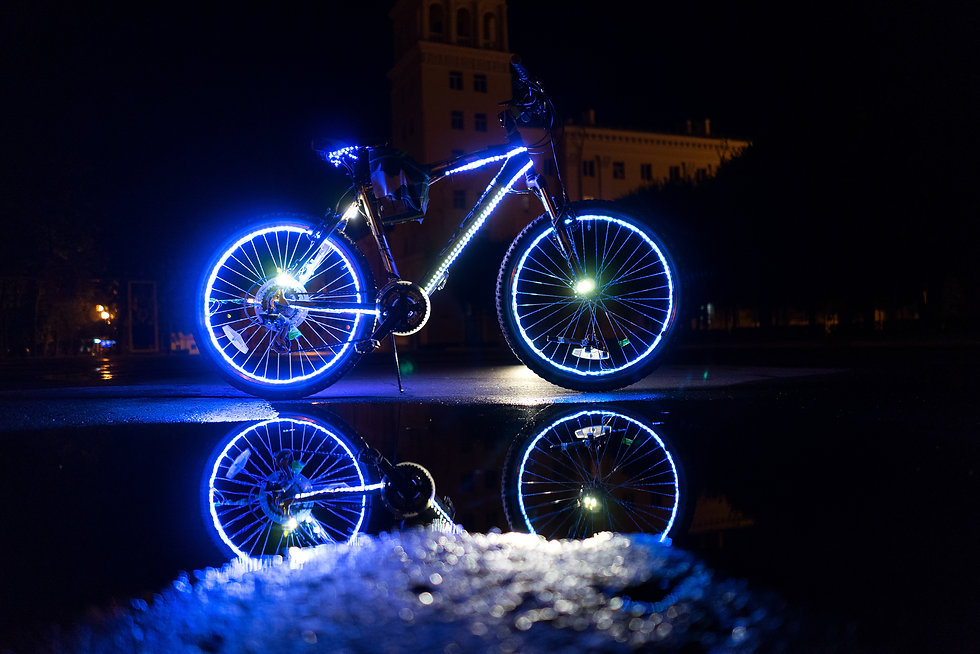 Glowing bicycle is reflected in the wate