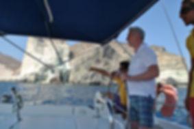 """Это удивительное захватывающее путешествие на яхте или катамаране вдоль южного побережья острова, с посещением Красного и Белого пляжа. Мы обогнем мыс Акротири, остановимся на Белом острове, вулкане с посещением кратера, по желанию купание в горячем источнике вулканического происхождения. Встреча романтического заката с борта яхты, вряд ли оставит Вас равнодушными. С палубы Вы увидите """"кружевные"""" берега, роскошные пляжи, """"бирюзу"""" заливов. Увидите величие острова с самой протяженной Кальдерой в мире."""