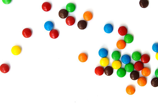 A scattering of colored small chocolates