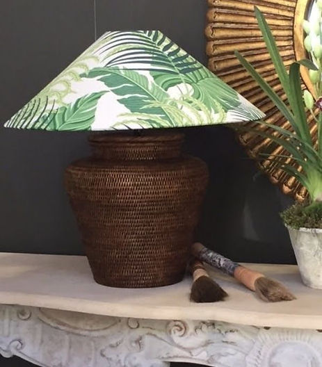A lampshade with leaves on it