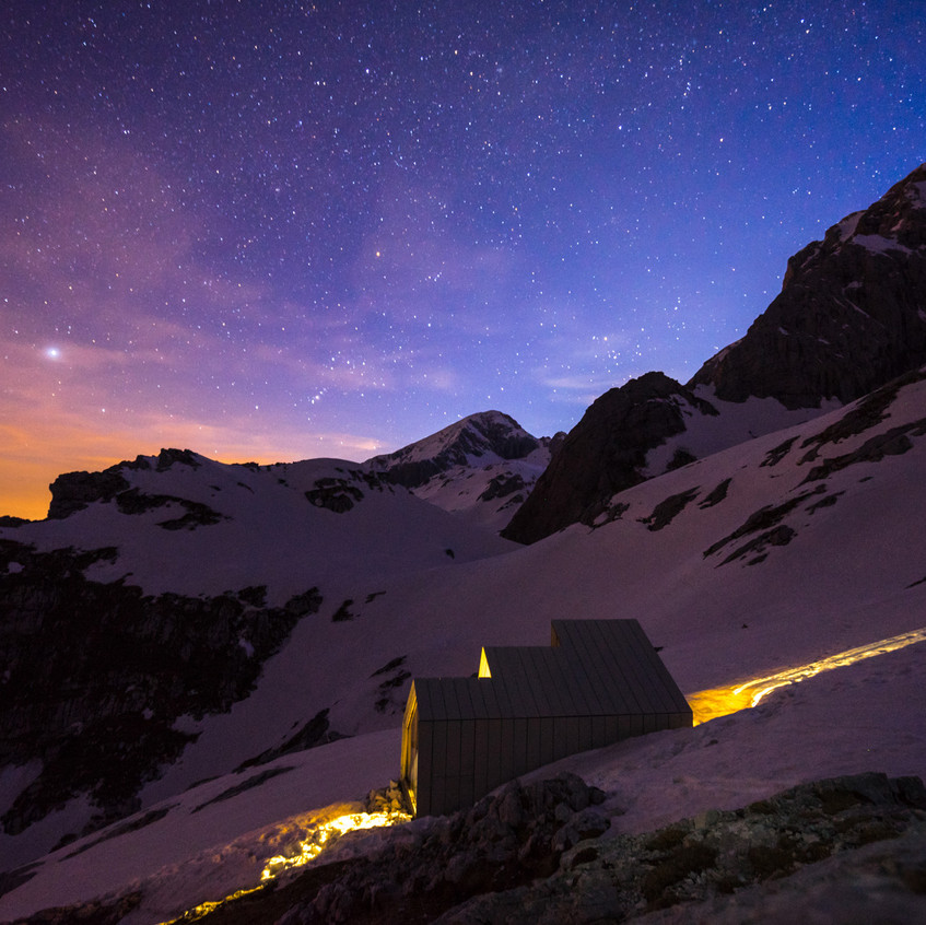 Mountain shelter in the night.