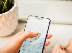 woman-holding-phone-using-calendar_25340