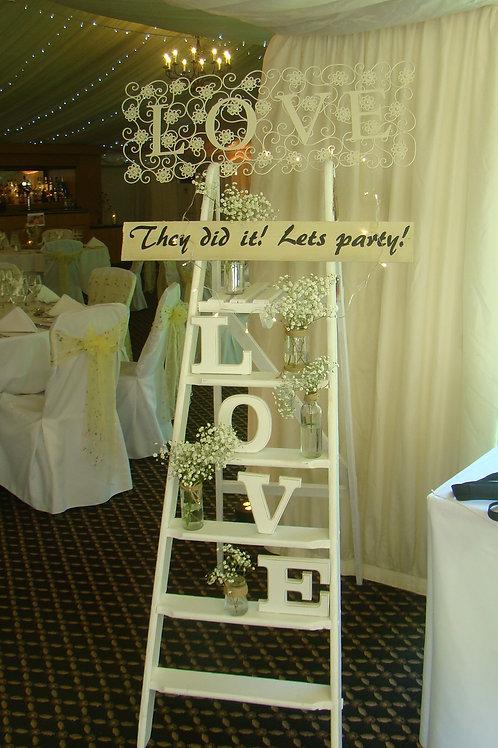 Decorated vintage step ladder