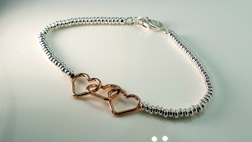 Trio Of Entwined Rose Gold Hearts