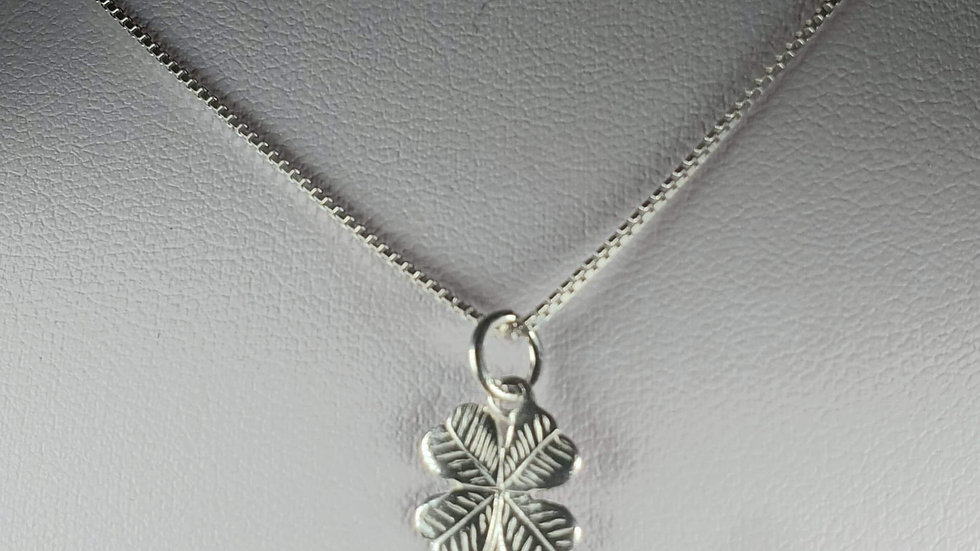 Silver patterned lucky four leafed clover
