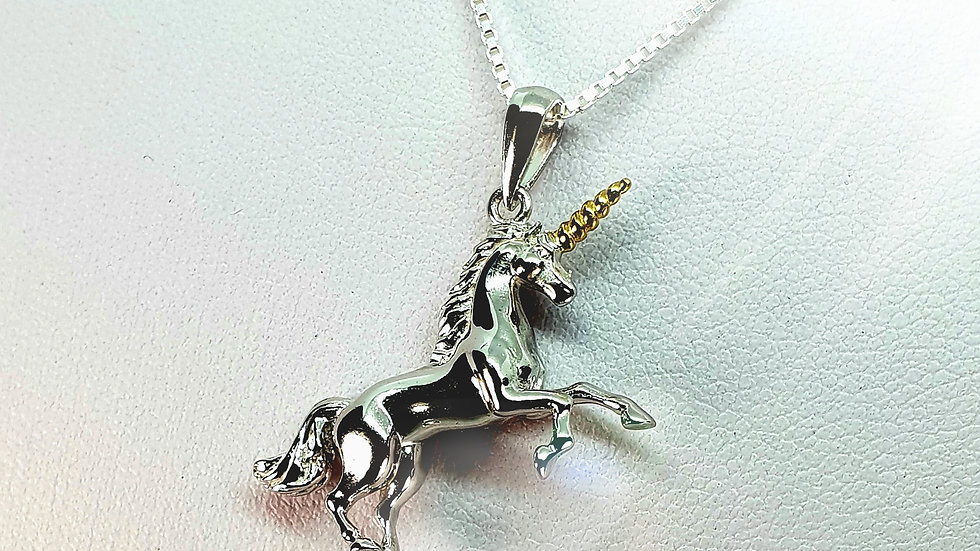 Unicorn With Gold Tipped Horn
