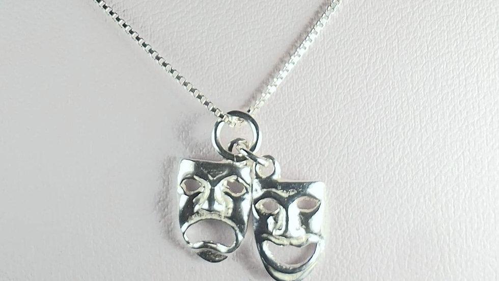 Theatre masks in silver