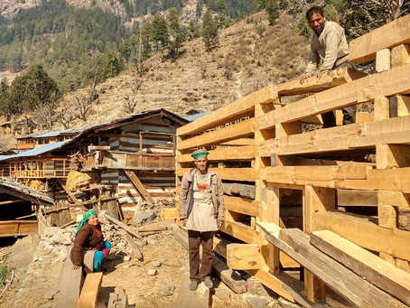 Wooden house under construction in Kalap