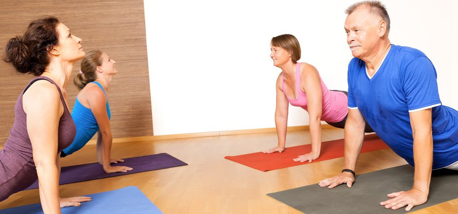 An image of some people doing yoga exerc