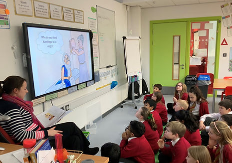 Teacher reading Hemlock