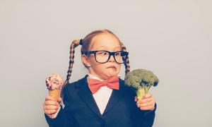 girl holding an ice cream and broccoli