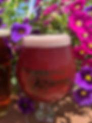 A 12 oz glass of Raspberry Wheat ale