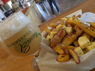 A beer and poutine