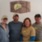 picture of Owners Megan McDonald, Kurt McDonald, Sallee Ten Eyck and Jeff Ten Eyck under the Summerhill Brewing sign