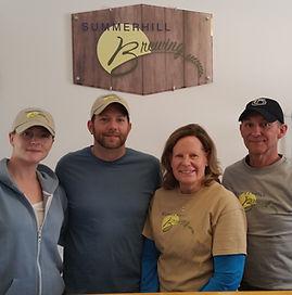 picture of Owners Megan McDonald, Kurt McDonald, Sallee Ten Eyck and Jeff Ten Eyck under the Summerhill Brewing sign