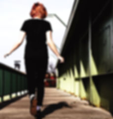 Lady walking o the bridge - edited