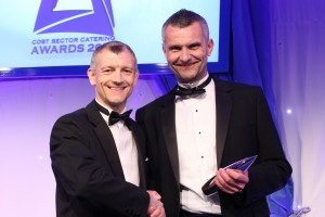 Damon Brown accepting Cost Sector Award for Contract Caterer of the Year
