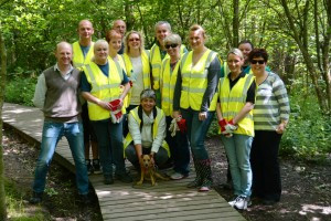 OLIVE VOLUNTEERS GET GREEN-FINGERED IN AID OF LOCAL WOODLAND