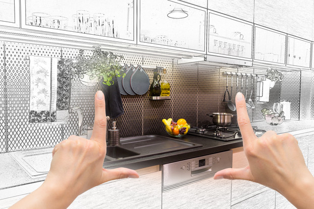 Female hands framing custom kitchen desi