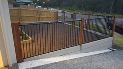 Flat Top Fencing on Retaining Wall