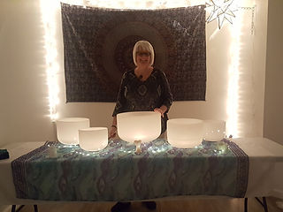 Denise with crystal bowls at the sacred