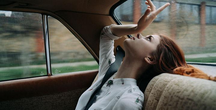 Unhappy girl in car