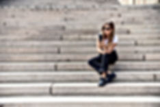 young girl sitting on stair