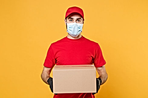 Delivery man employee in red cap blank t