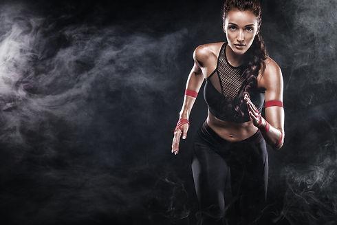 A strong athletic, woman sprinter, runni