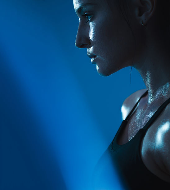 Close up of young woman in sports bra wi
