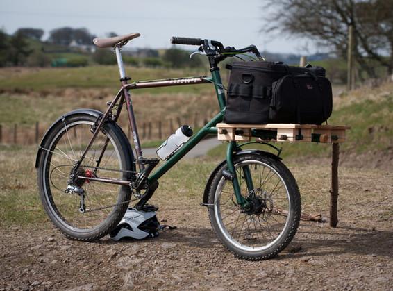 Retro mountain bike modded into cargo bike.
