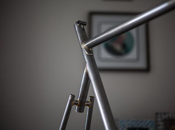 Fillet brazed track frame with segmented wishbone seatstays.