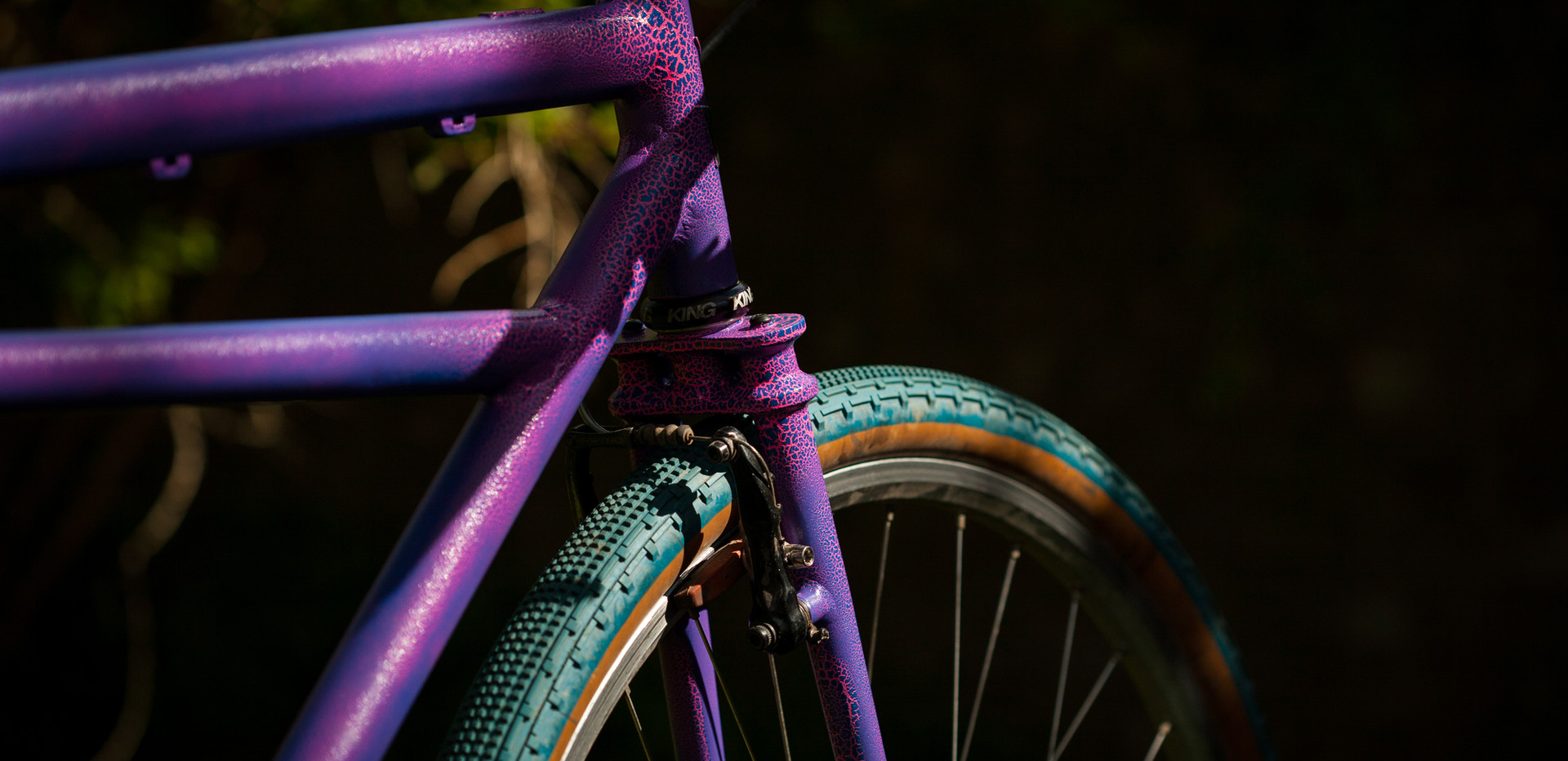 Klunker style gravel frameset with twin plate fork crown and crackle paint.