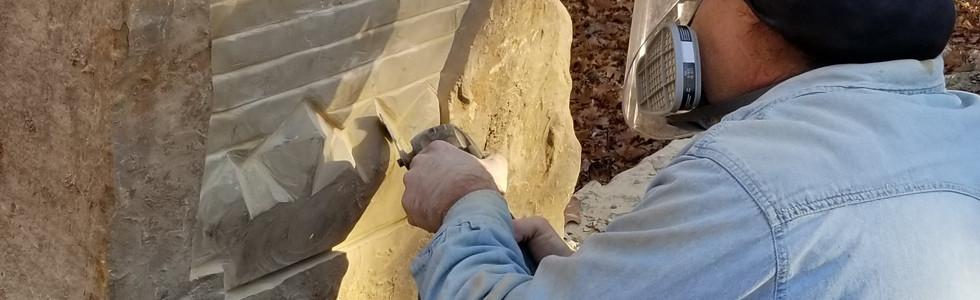 Stephen at work carving Oz Trail logo
