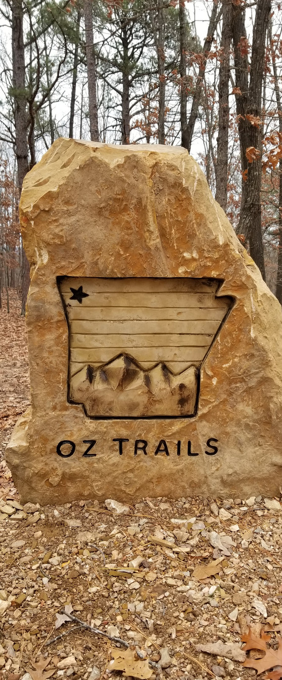 Oz Trails Logo at Lake Leatherwood Gravity Downhill Bike Trailhead