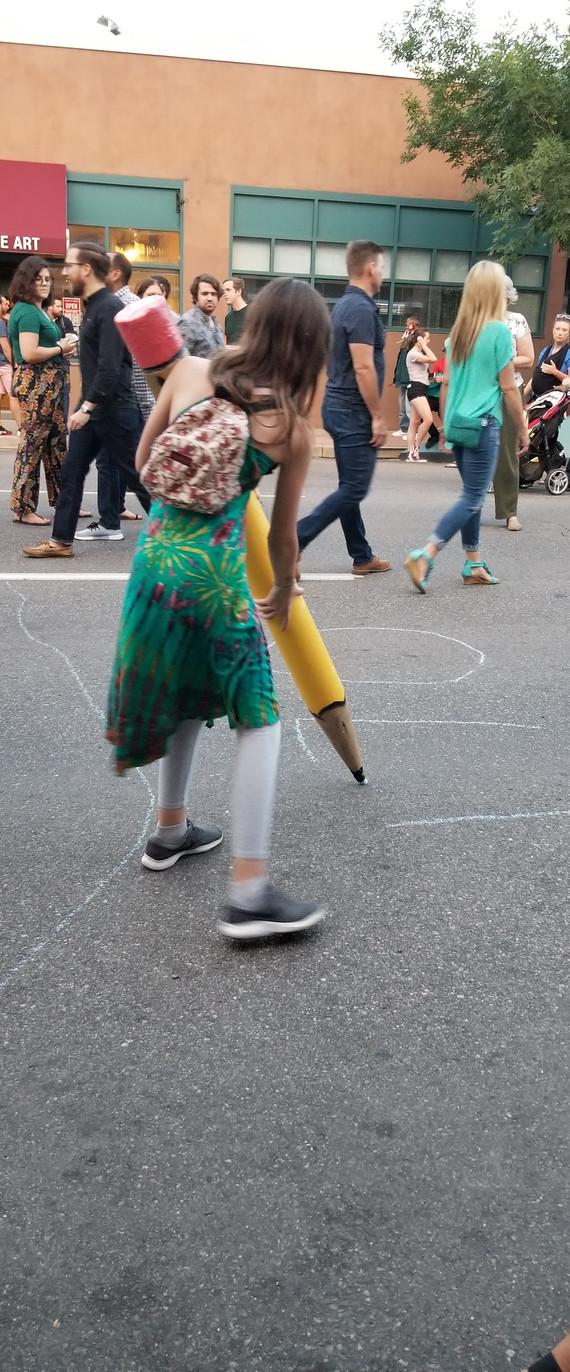 Young Lady having fun with Sidewalk Chalk Pencil