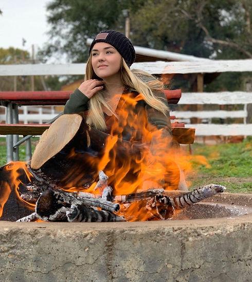 girl behind fire.jpg