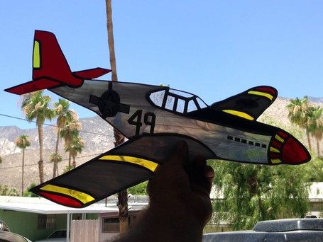 Tuskegee plane in the light.jpg
