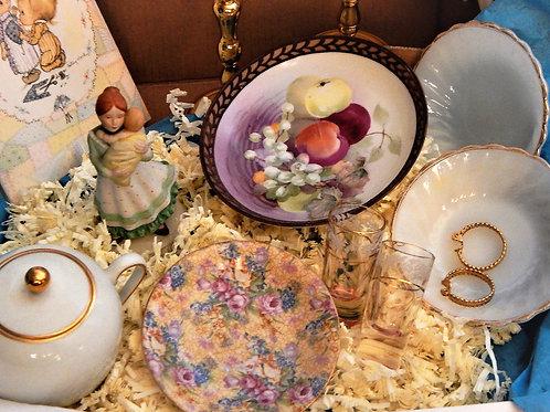 Photograph of vintage home decor,pomander,candelabra,dishes jewelry box.Vintage home decor mystery subscription treasure box.