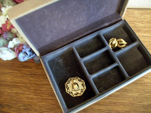 Photograph of a beige suede vintage Avon compartment jewelry box from A Vintage Addiction