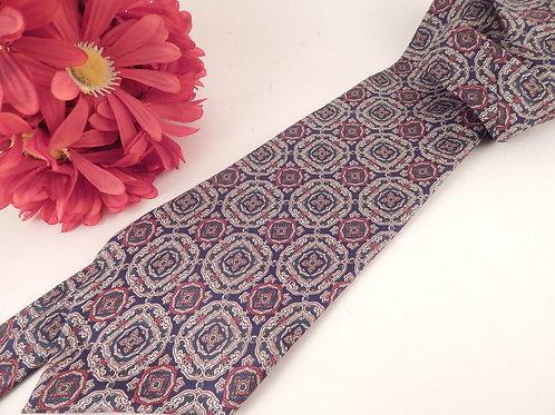 Photograph of a Mens Neck Tie Designer Henri Christian Black and Gold Geometric All Silk Necktie Vintage HC